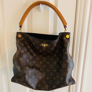 Louis Vuitton Gaia monogram canvas w Black accent
